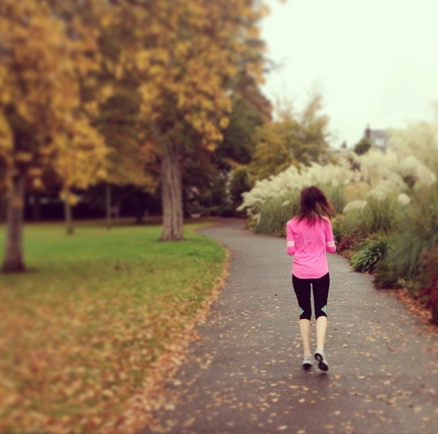 running in the autumn leaves